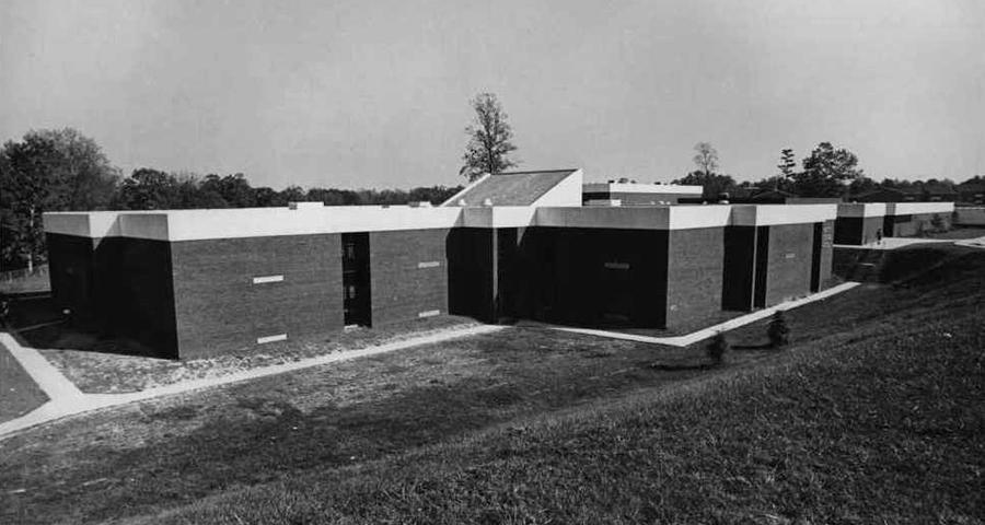 Black and white photograph of the completed Forest Edge Elementary School. The photograph is undated but was probably taken shortly after the building opened because of the trees planted in front of the school. These trees are not visible on aerial imagery after 1976.