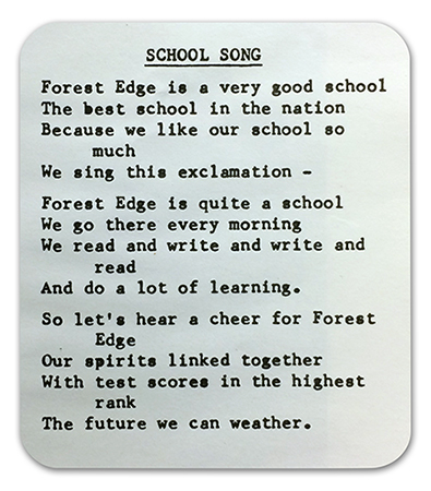 Photograph of a printing of the Forest Edge School Song from a yearbook. The text reads: Forest Edge is a very good school, the best school in the nation. Because we like our school so much, we sing this exclamation. Forest Edge is quite a school; we go there every morning. We read and write and write and read, and do a lot of learning. So let's hear a cheer for Forest Edge, our spirits linked together. With test scores in the highest rank, the future we can weather.